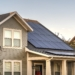 Solar photovoltaic panels on a house roof. Solar photovoltaic panels on a house roof for providing sustainable alternative energy from natural resources